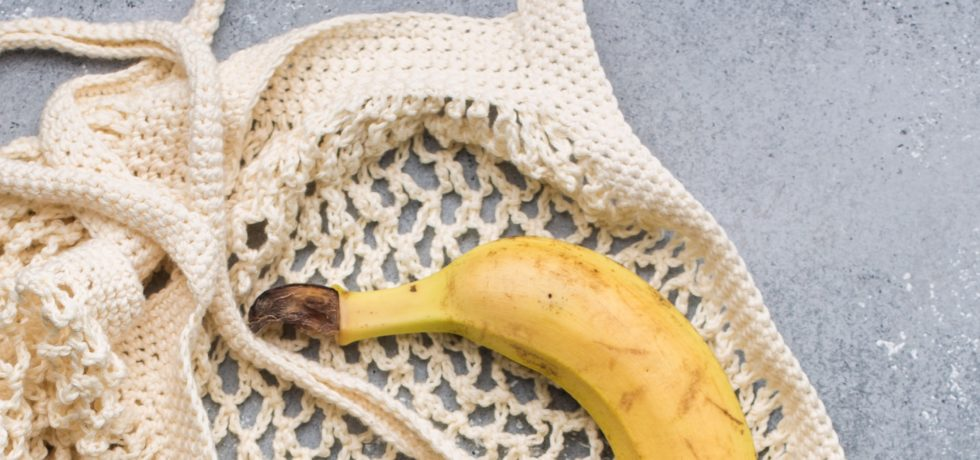 banana in netted shopping bag